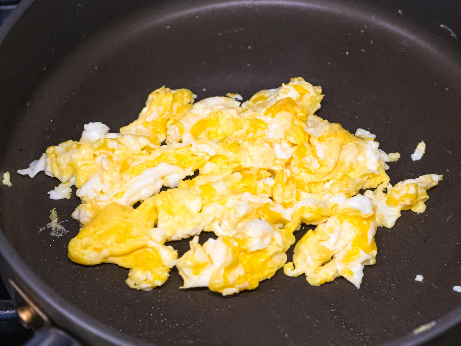 scrambled eggs in a nonstick pan