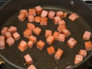 spam cubes fried in a nonstick pan