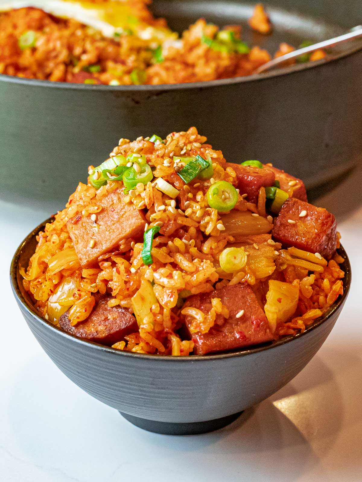 bowl of kimchi spam fried rice with scallions
