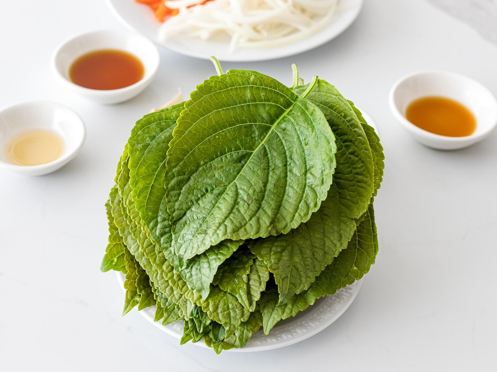 perilla leaves with soy sauce and sesame oil in small bowls