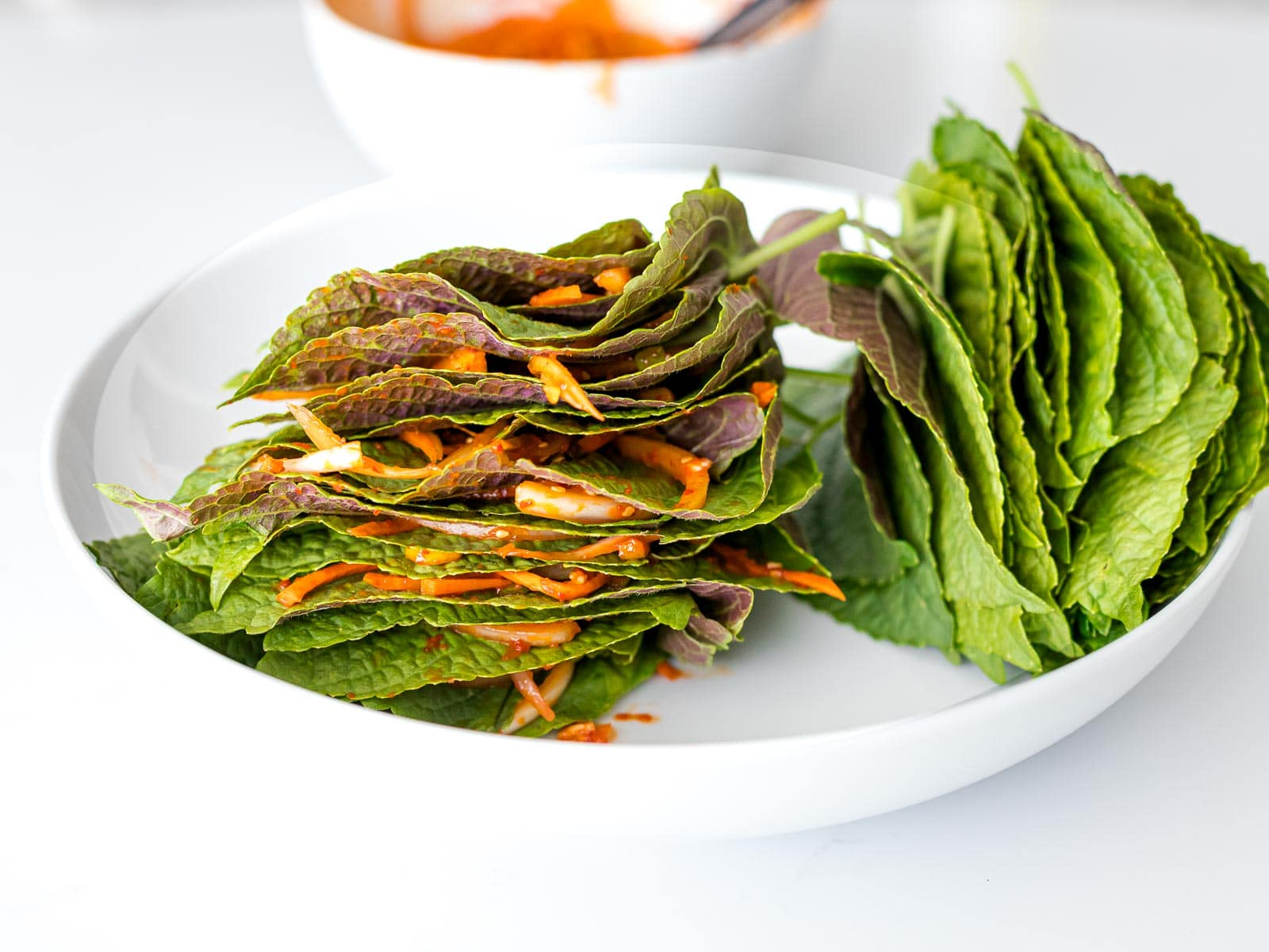 stack of perilla leaves layered with kimchi marinade