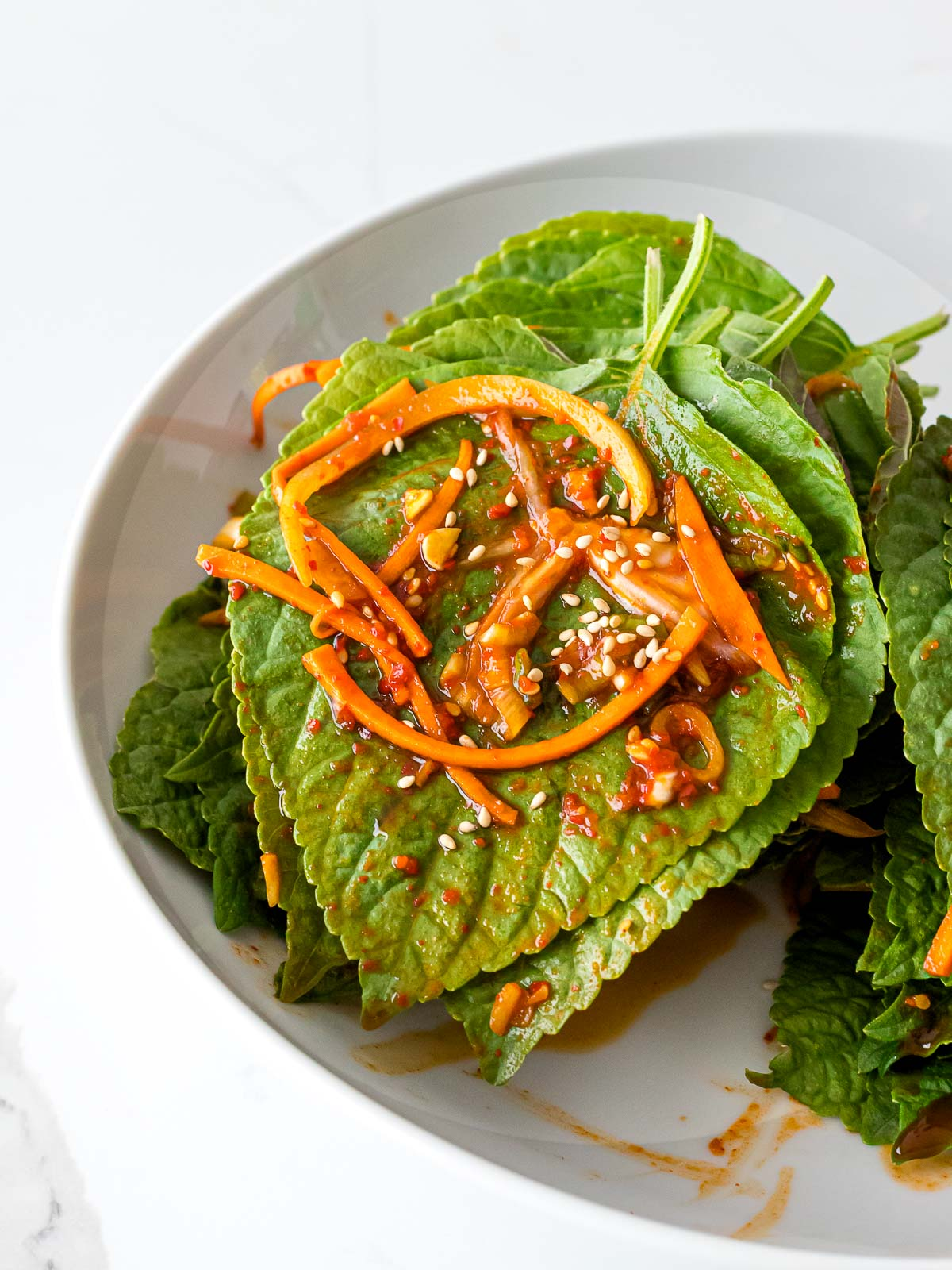 Korean perilla leaves marinated in a garlic soy sauce with shredded carrots