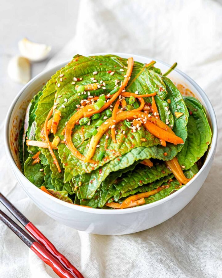 Korean perilla leaf kimchi marinated in a spicy garlic soy sauce with shredded carrots