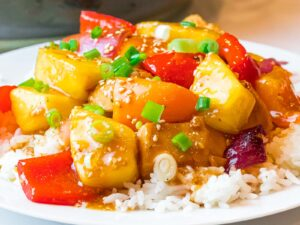pineapple chicken stir fry served over rice