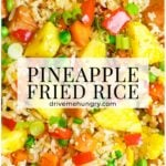 pineapple fried rice with pineapple chunks, red bell pepper, and peas