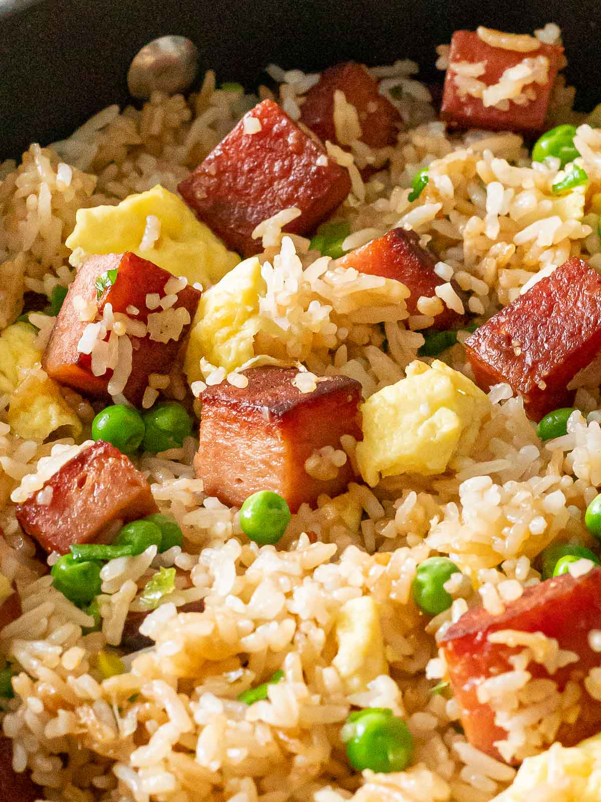 crispy spam fried rice with eggs and peas