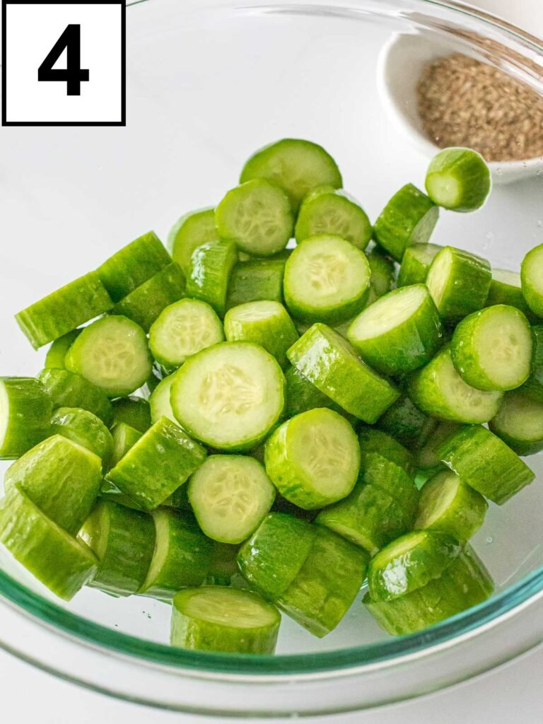 salted cocktail cucumbers in a glass bowl