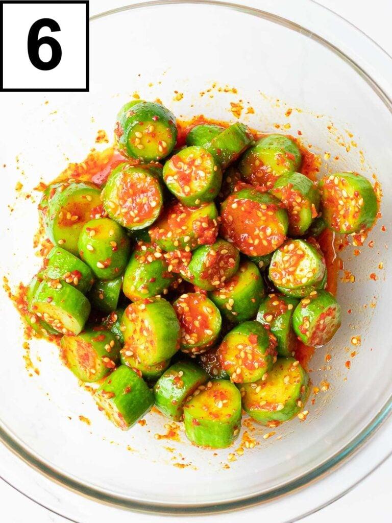 glass bowl of spicy Korean cucumber salad