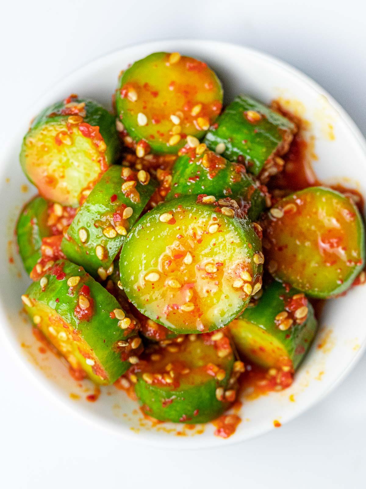 spicy Korean cucumber salad (Oi Muchim) on a white plate