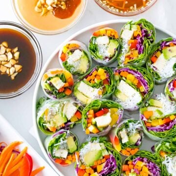Vietnamese vegetarian summer rolls with rainbow veggies with peanut sauce, hoisin sauce, and dipping sauce