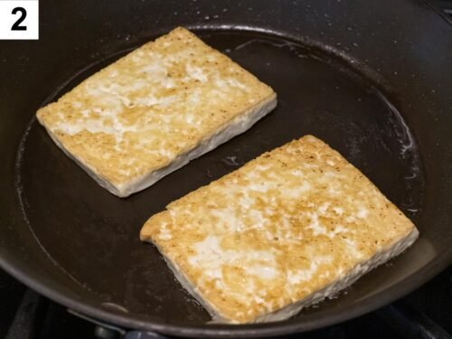 tofu being pan fried until golden brown