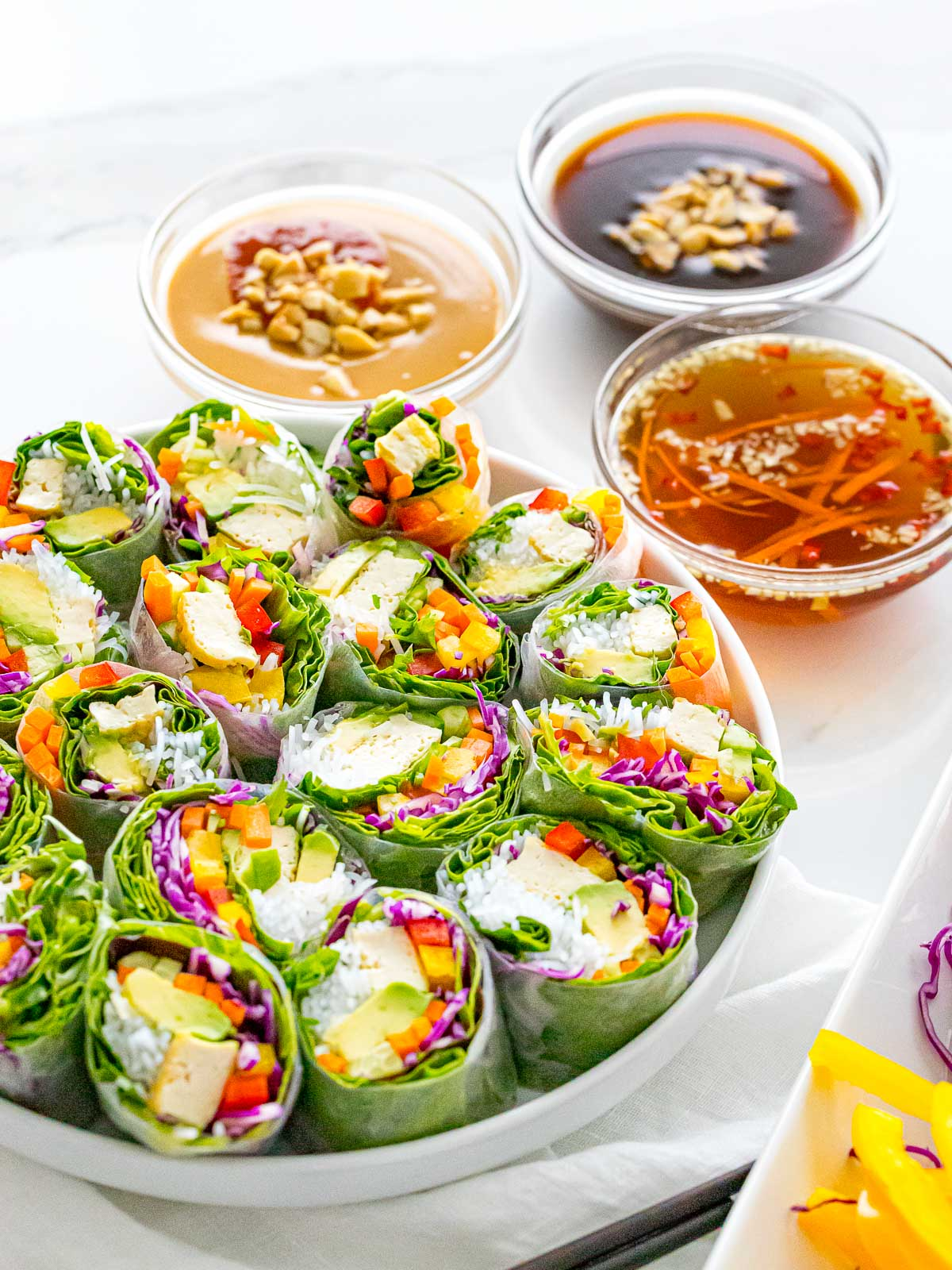 Vietnamese vegetarian summer rolls with peanut sauce, hoisin sauce, and nuoc cham