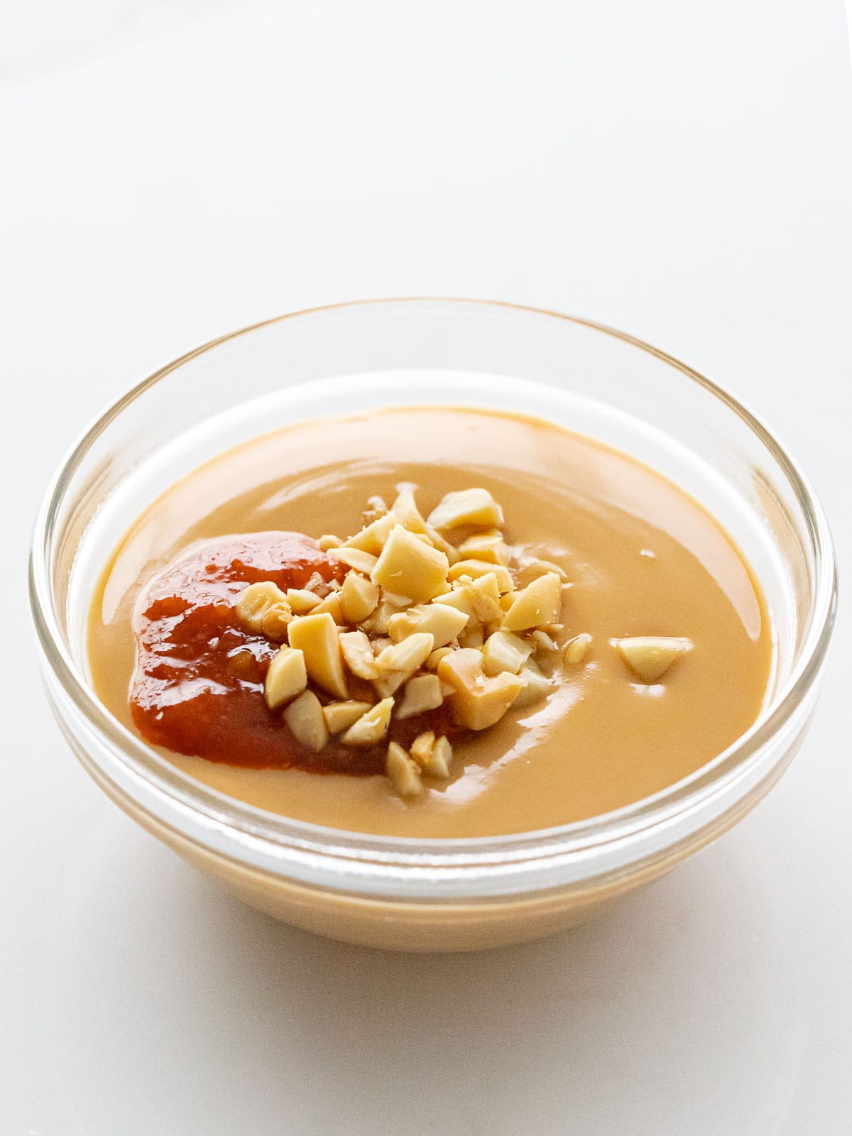 Vietnamese peanut dipping sauce with red chili sauce and crushed peanuts