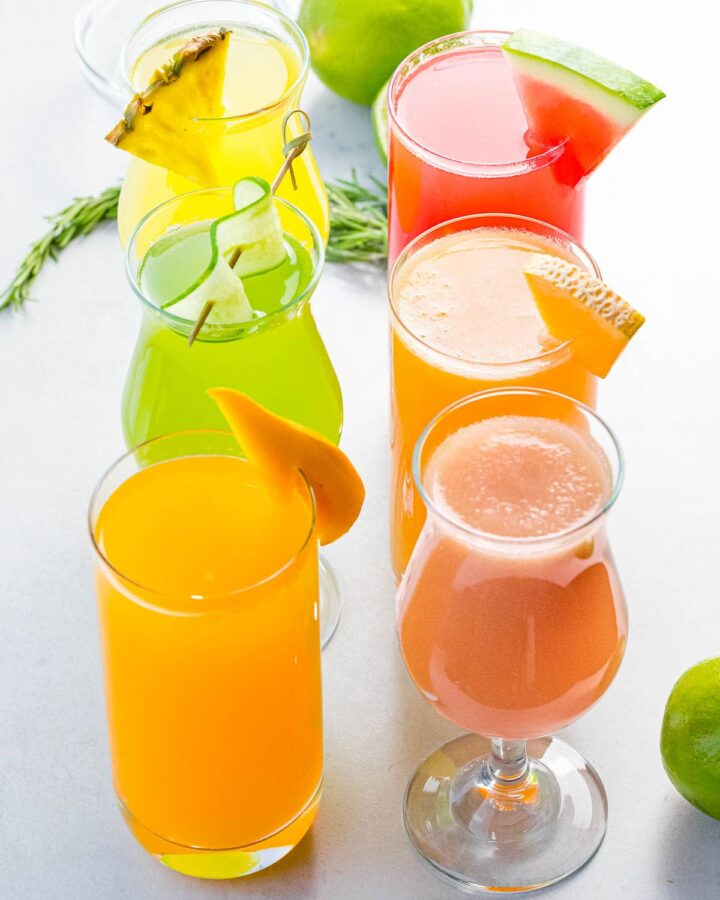 several fruit flavors of aguas frescas in glasses