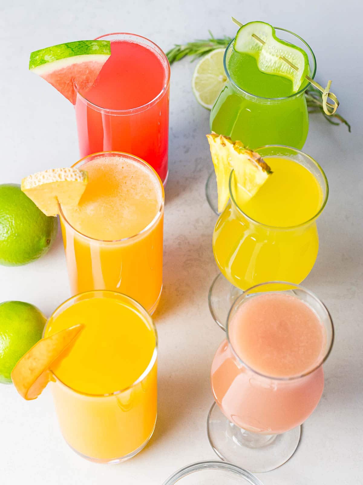 flavors of refreshing agua fresca fruit drinks in glasses with fruit garnishes