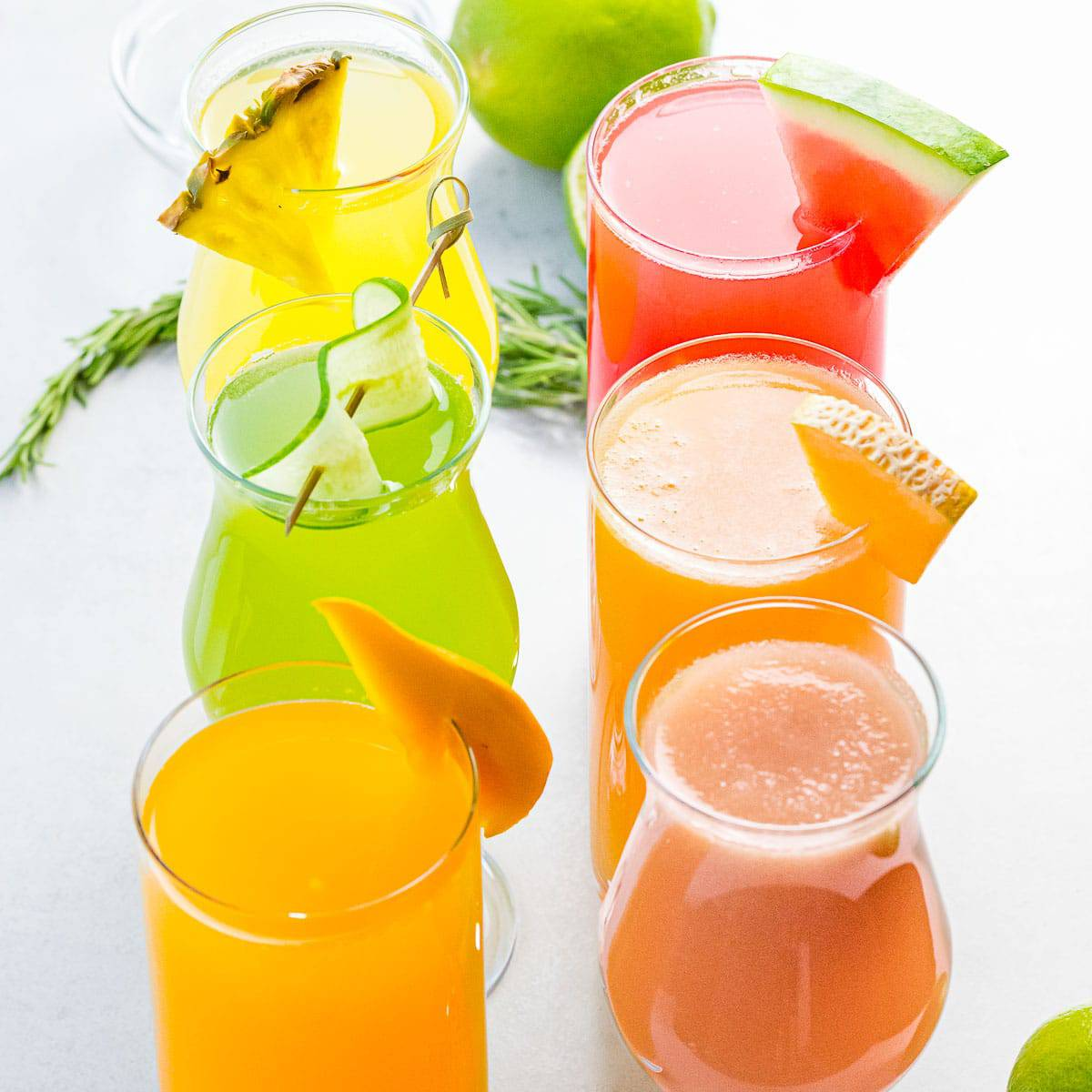 close up of aguas frescas flavors including watermelon, cucumber, mango, pineapple, and cantaloupe