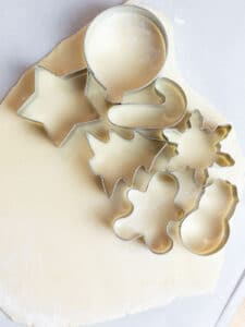 cookie cutters placed on top of rolled sugar cookie dough