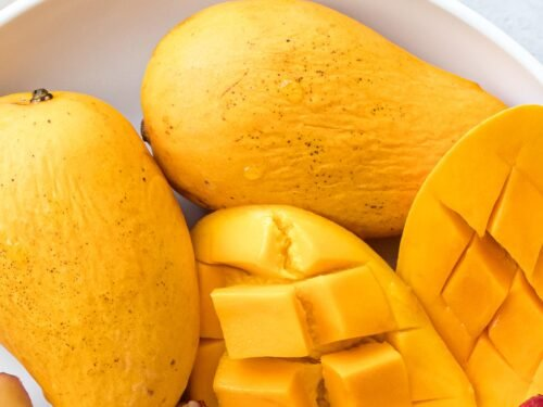 mangos cut up in a white bowl