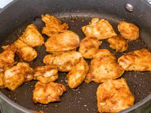 chicken stir fried in a pan