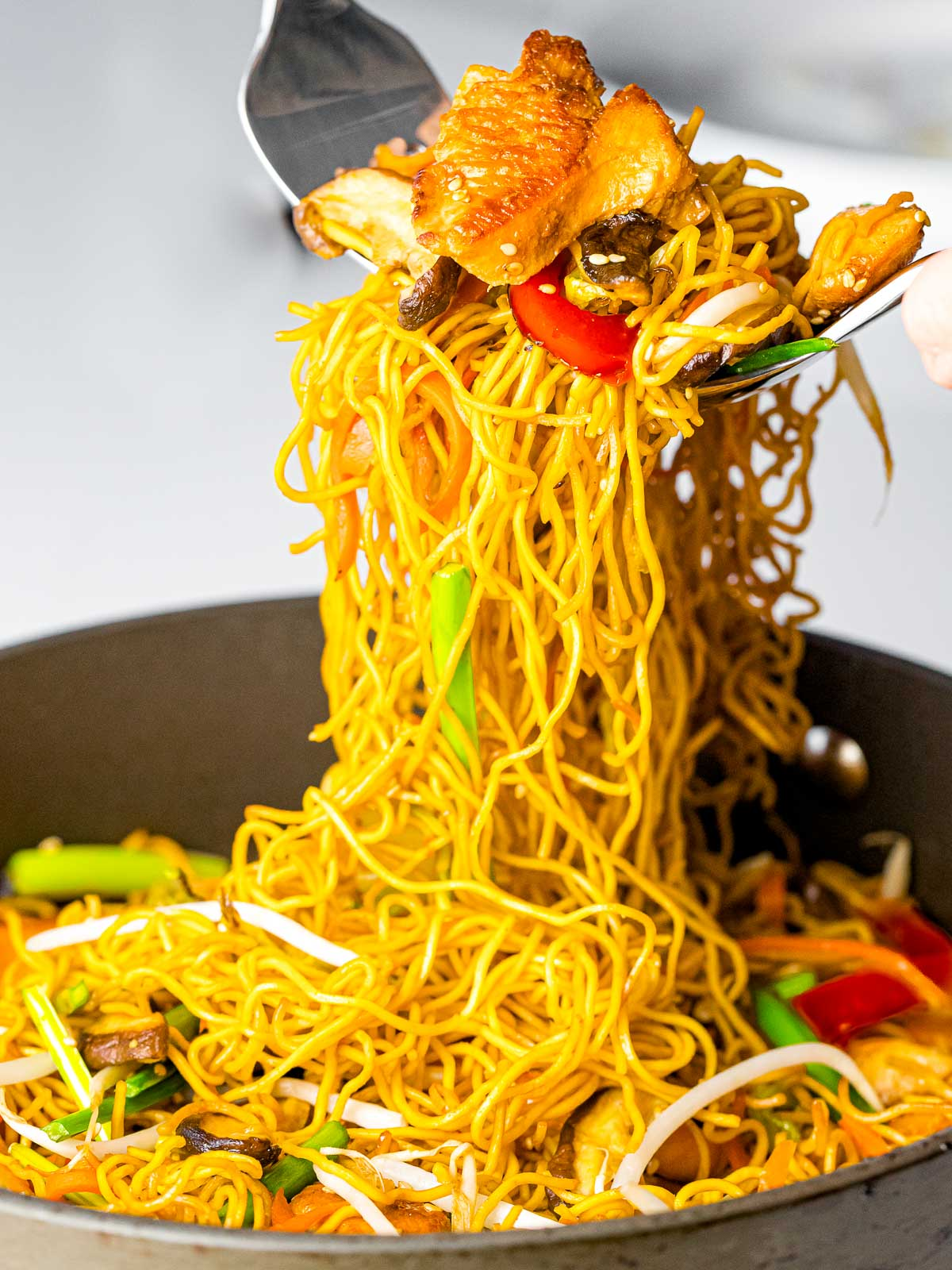 chicken chow mein noodles with vegetables served out of the pan