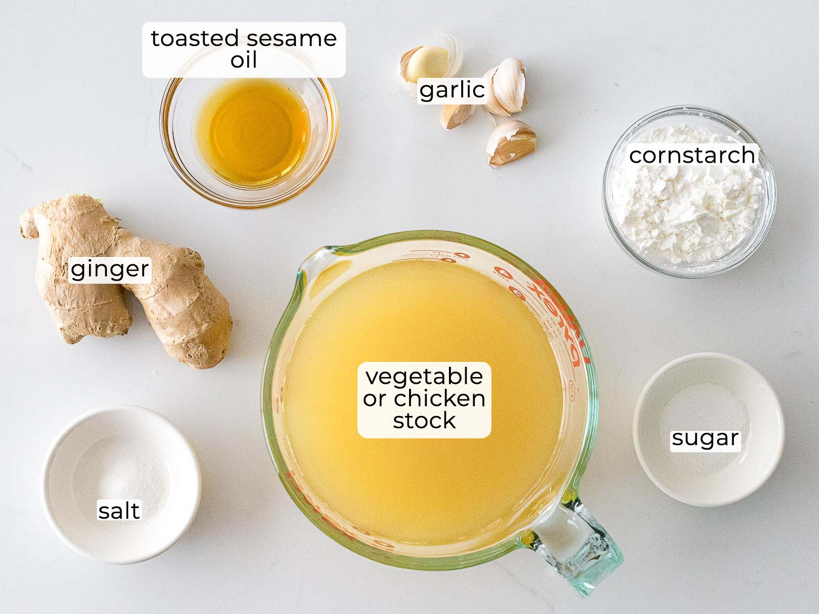 Chinese white sauce ingredients in glass bowls with text label overlays