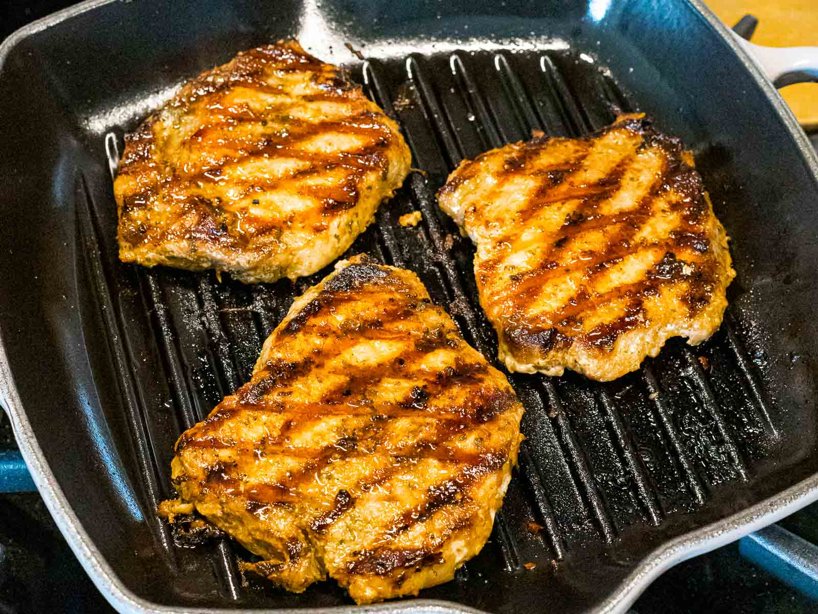 easy grilled pork chops with grill marks in a pan