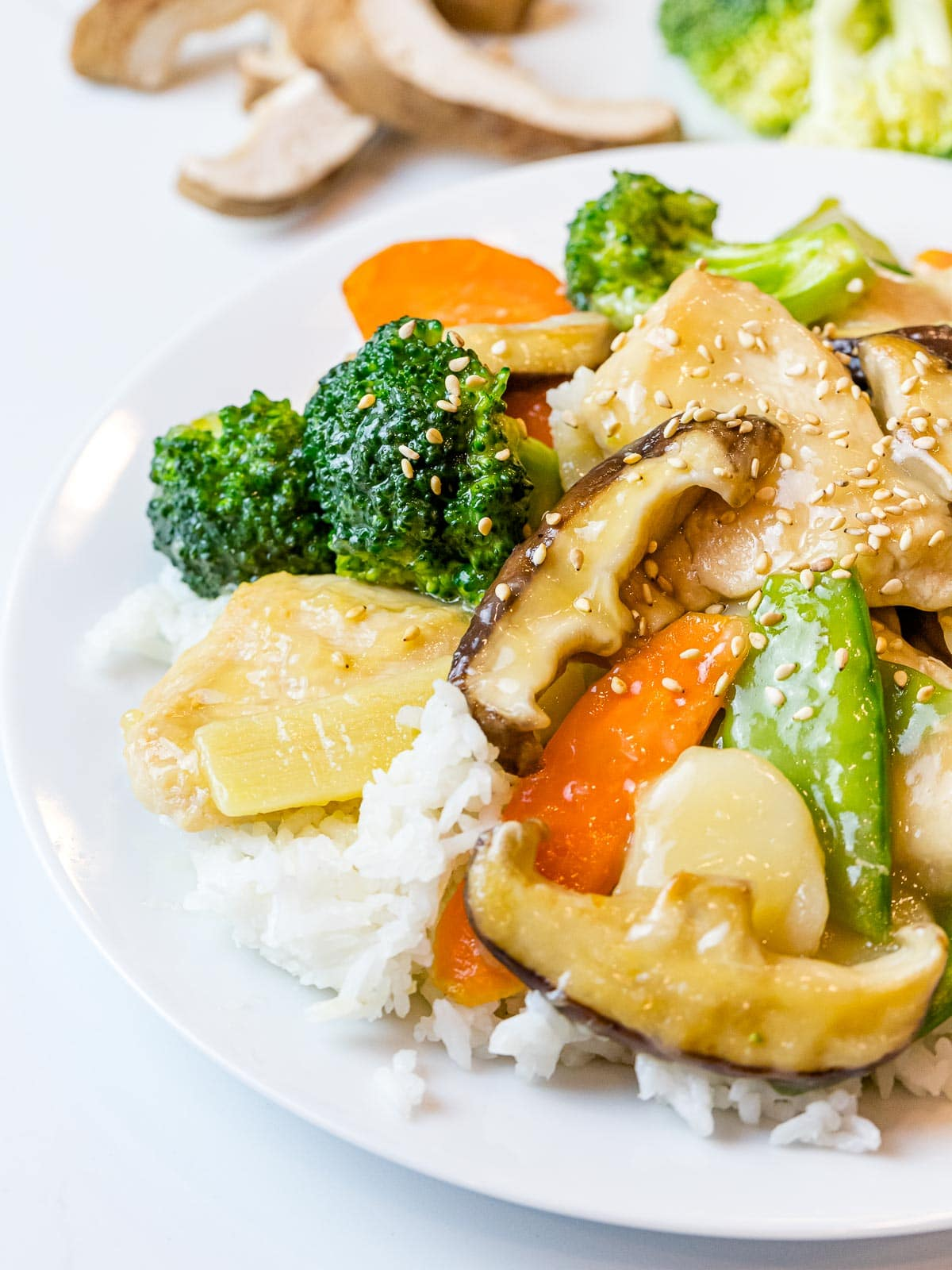 Chinese moo goo gai pan stir fry on a plate of white rice