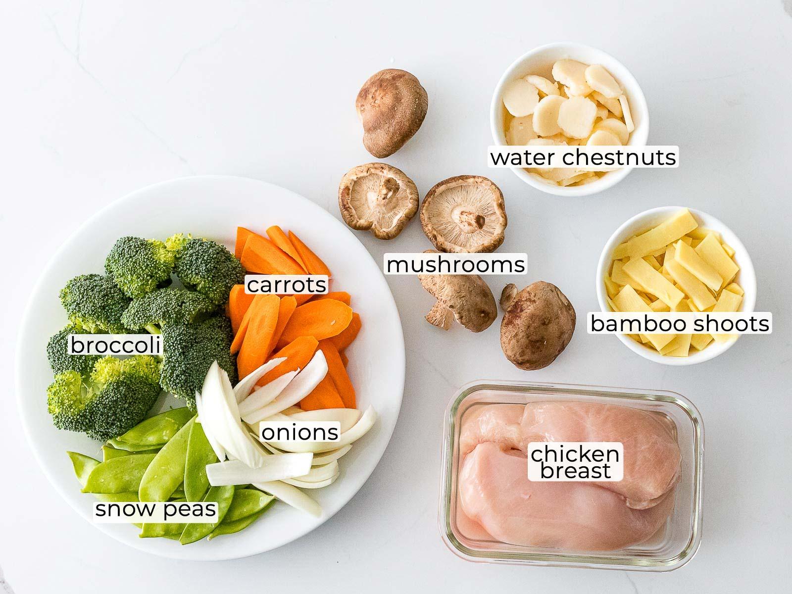 moo goo gai pan ingredients in bowls