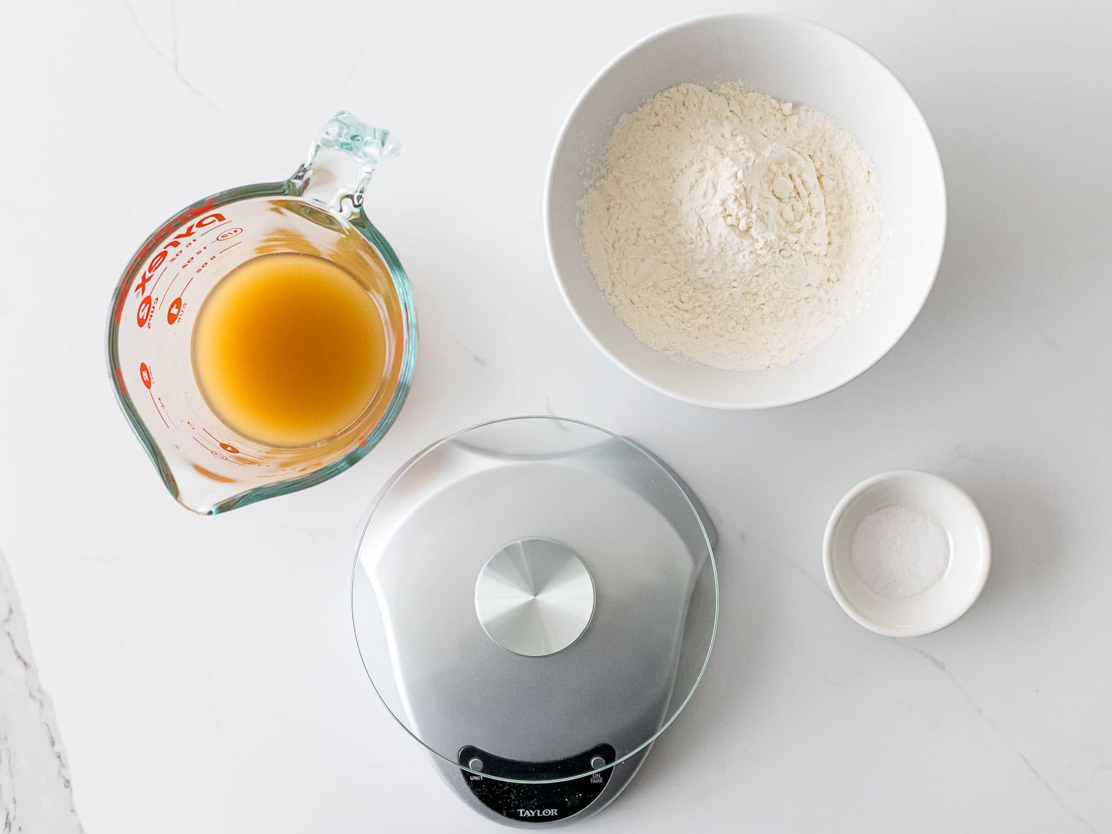 ingredients for yeast water starter including flour, kitchen scale, and salt