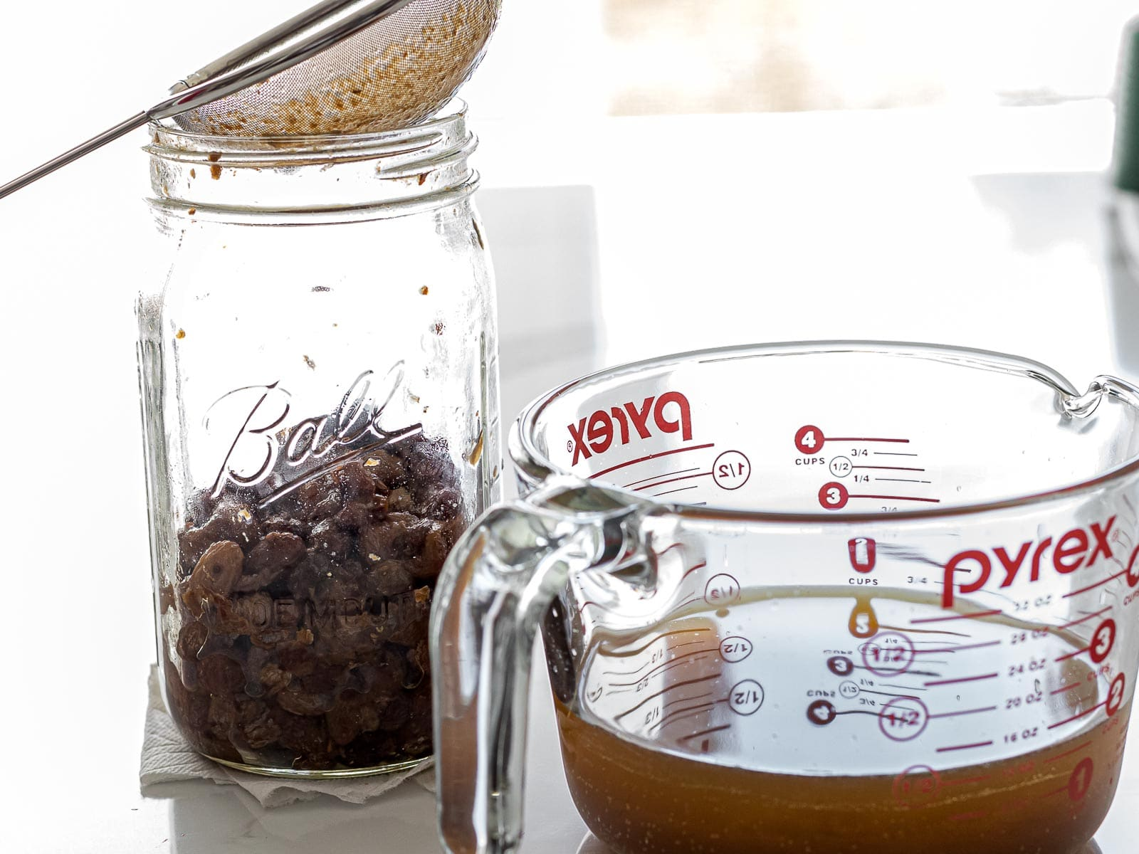 raisin yeast water strained with a mesh strainer and filled in a measuring cup