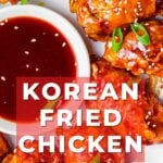 Korean fried chicken wings surrounding gochujang dipping sauce