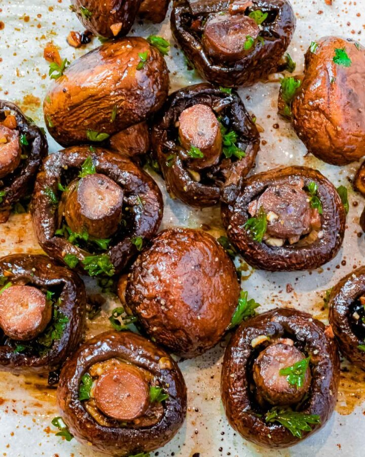 overhead of whole oven roasted mushrooms with garlic and balsamic vinegar