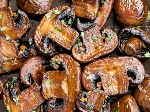 close up of twice cooked mushrooms with garlic butter and chopped parsley