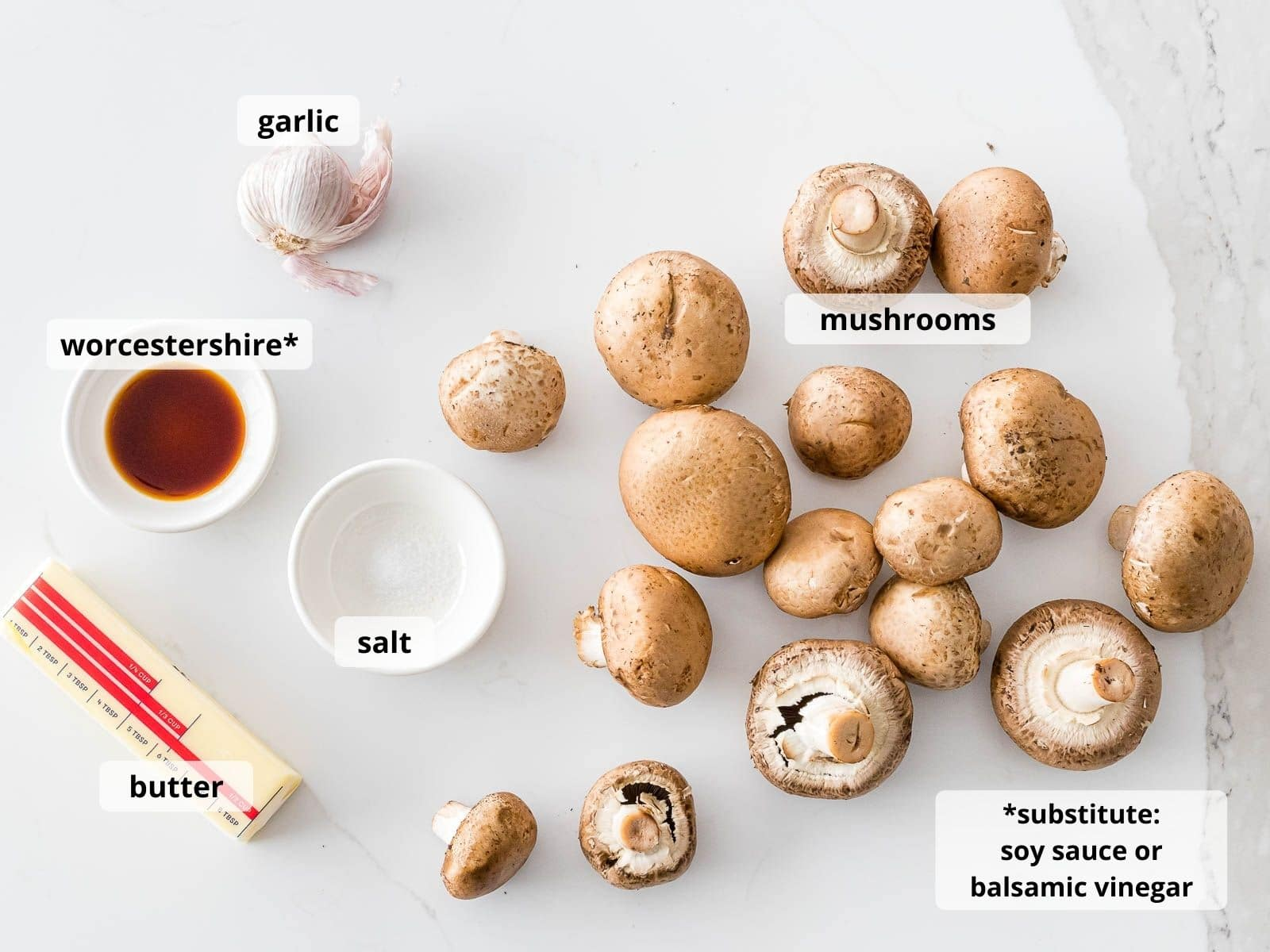 ingredients for garlic butter mushrooms with text labeling each ingredient