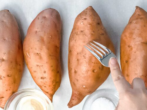 sweet potato being pierced with a silver fork