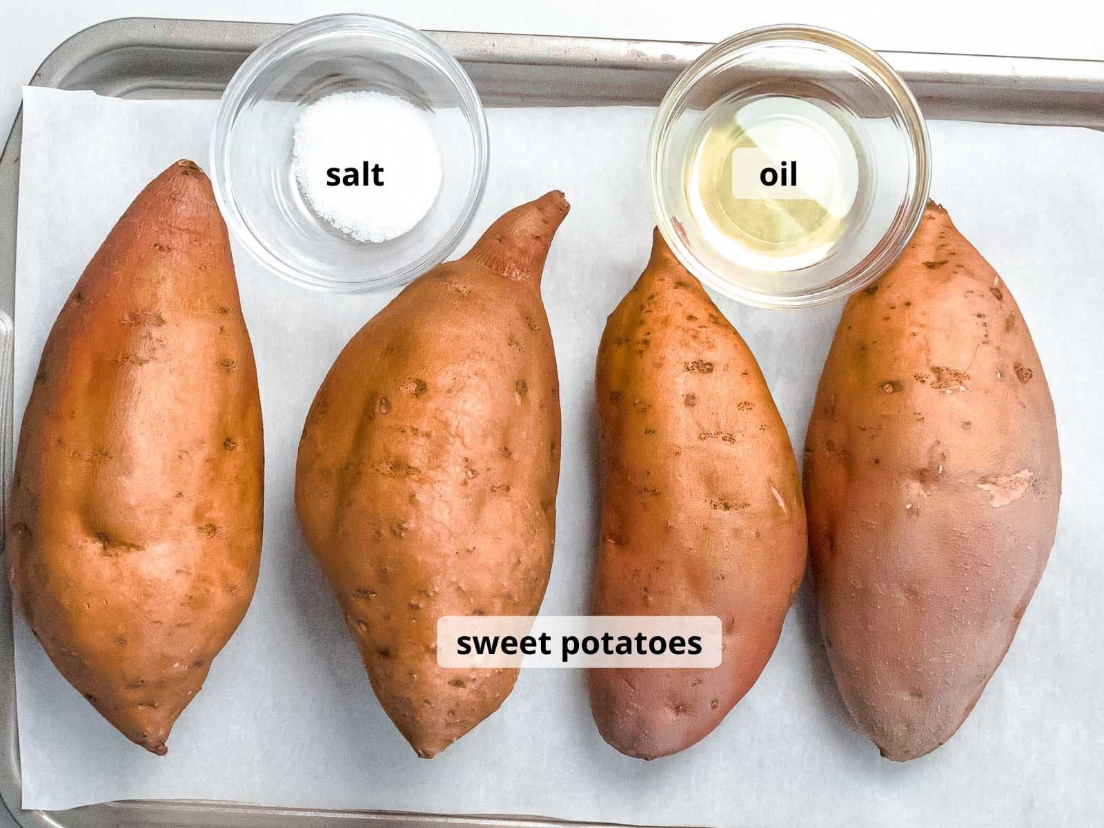 labeled ingredients for baked sweet potatoes in small ramekins on a baking tray lined with parchment paper