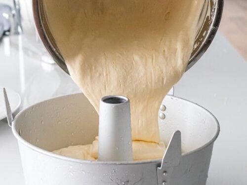 light, fluffy chiffon cake batter being poured into a chiffon pan
