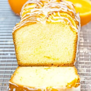 orange pound cake with glaze sliced open to reveal buttery moist crumb