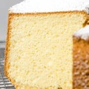 Close up of fluffy chiffon cake cut open to reveal soft sponge cake interior.