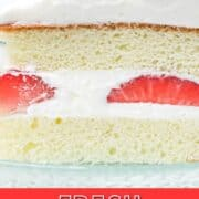 Close up of fresh strawberry cake with whipped cream with text overlay.