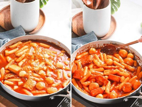 tteokbokki boiling in a large pan with rice cakes and red gochujang sauce