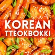 Korean tteokbokki made with rice cakes and fish cakes garnished with scallions and sesame seeds