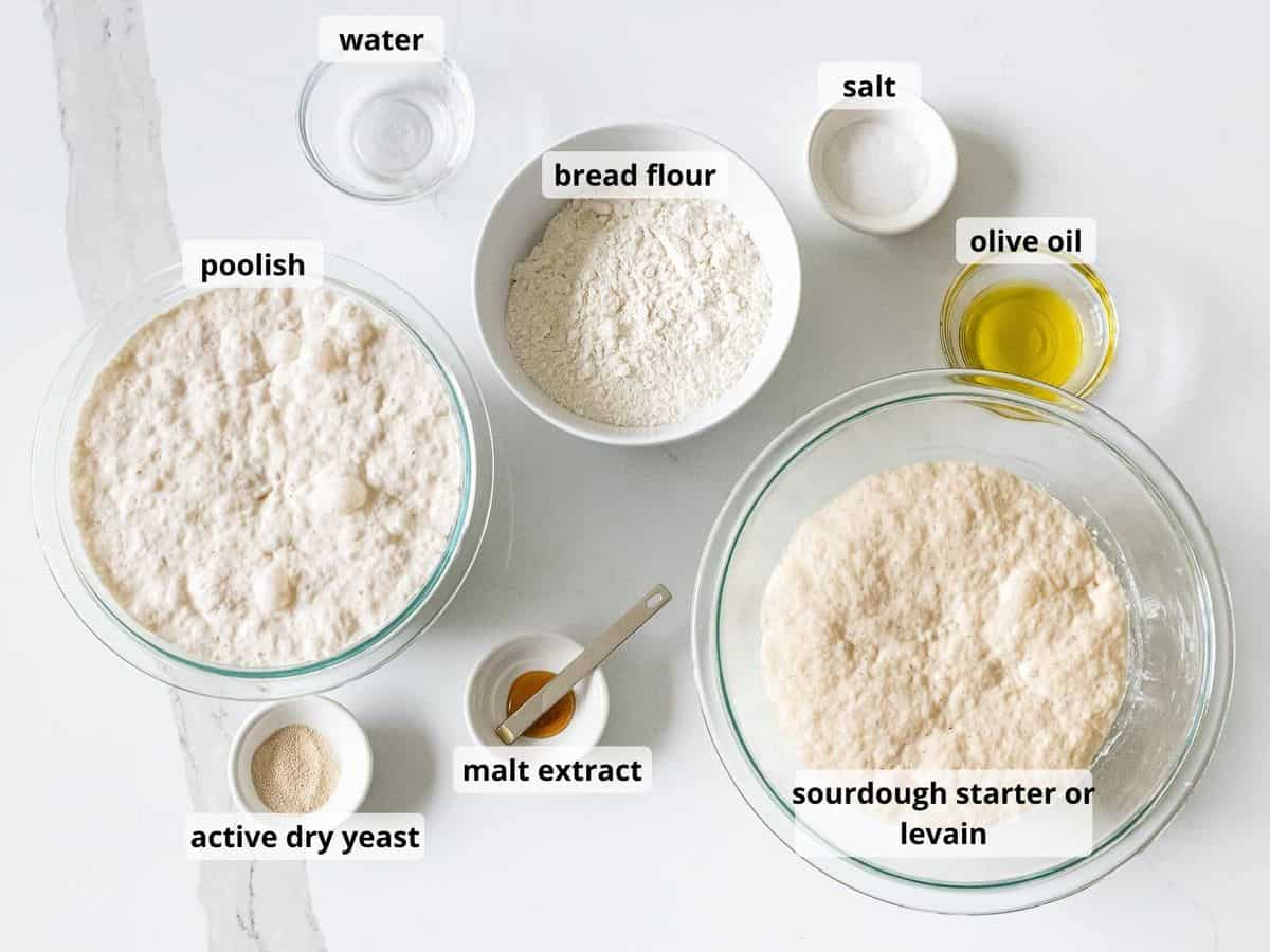Ingredients for sourdough ciabatta bread including flour, water, olive oil, and sourdough starter in glass bowls.