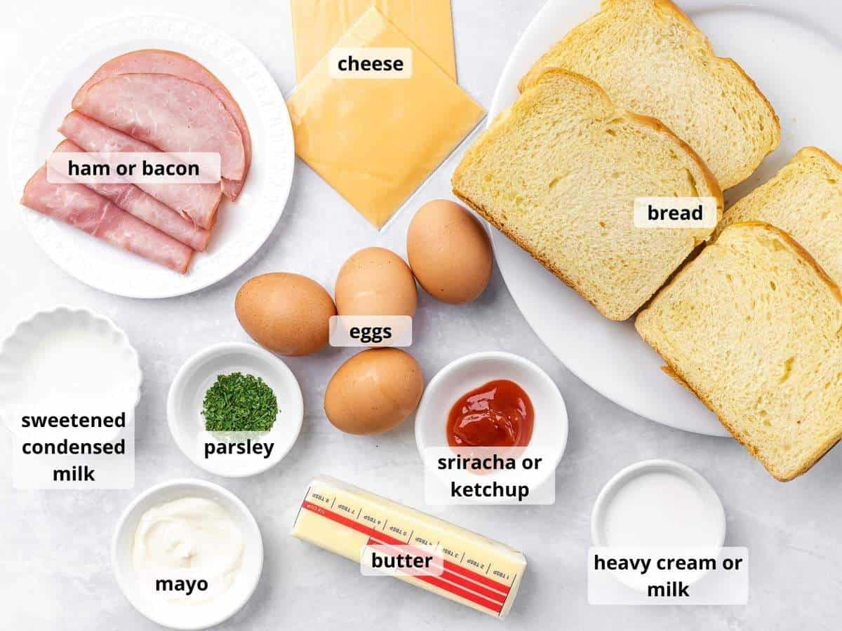 Labeled ingredients for Korean egg drop sandwich in small white bowls.
