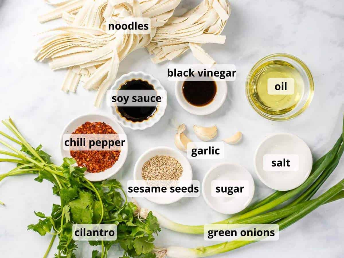 Ingredients for Szechuan noodles with garlic chili oil with text overlay.