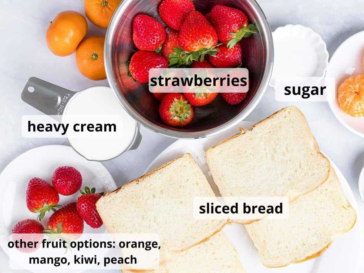 Labeled ingredients for Japanese fruit sandwich including strawberries, cream, and bread.