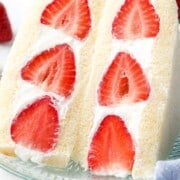 Close up of Japanese strawberry sandwich cut in half to reveal red strawberries and cream.