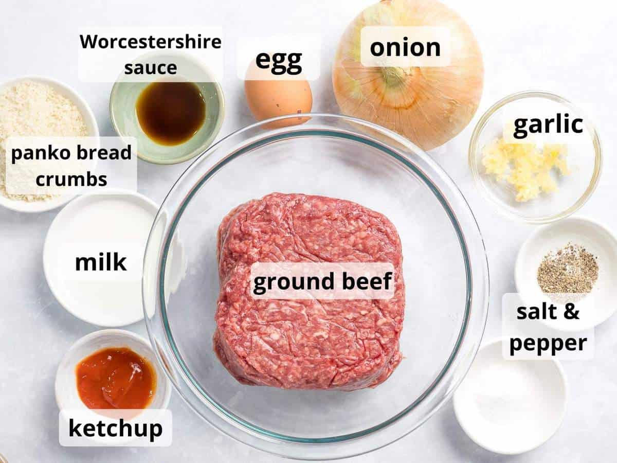 Ingredients for Japanese hamburger steak patty including ground beef, onions, and panko bread crumbs.