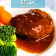 Japanese hamburger steak next to broccoli and carrots with steak sauce with a text overlay.