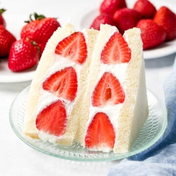 Japanese fruit sandwich or strawberry sando made with fluffy whipped cream, red strawberries, and Japanese milk bread.